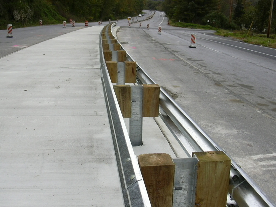 Steel guard rail on divided highway.