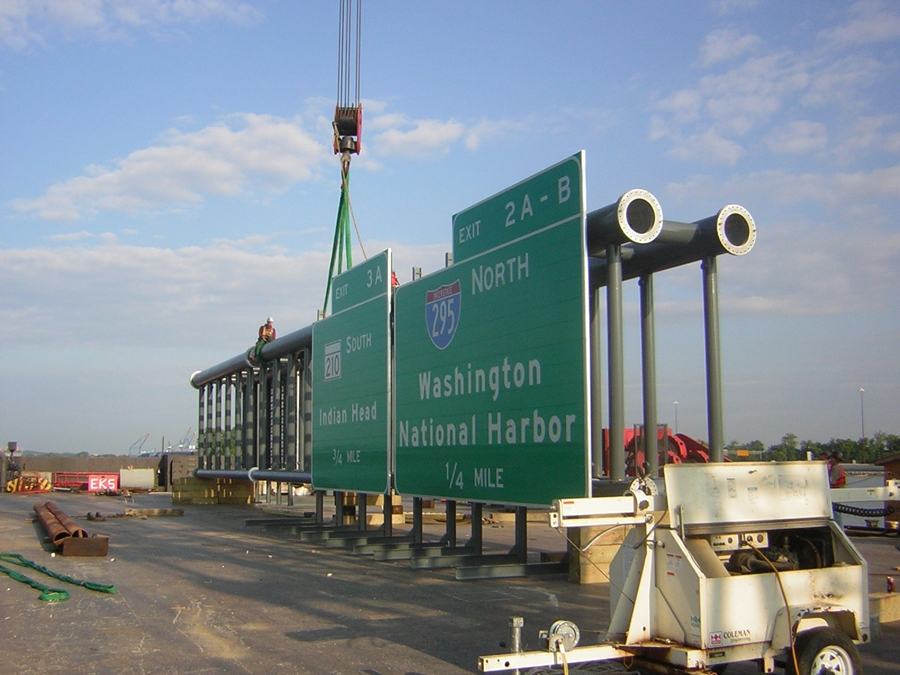 Sign about to be installed on a highway.