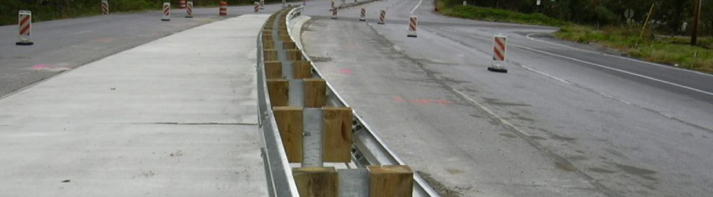 Guide rails on a highway installed by Collinson Inc.