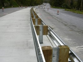 Steel guard rail on divided highway. guardrail repair